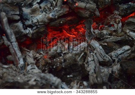 Glowing Embers In Hot Red Color. The Hot Embers Of Burning Wood Log Fire. Firewood Burning On Grill.