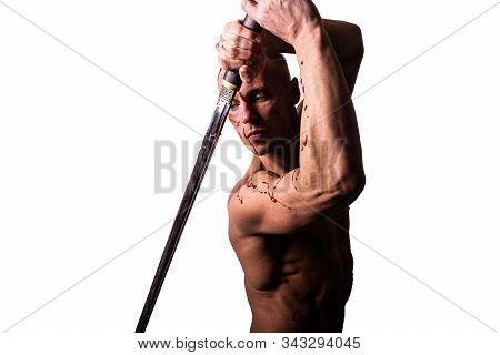 Handsome Man With A Bare Torso And Blood. Posing With A Sword. Isolated On A White Background.