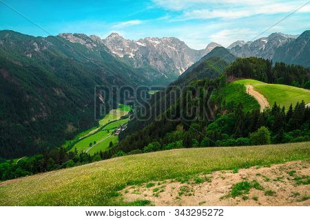 Beautiful Spring Landscape With Alpine Meadows And Snowy Mountains In Slovenia. Logarska Dolina And