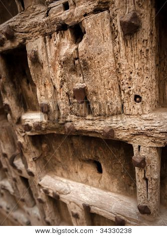 Ancient wooden door with weather beaten