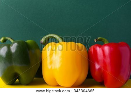 Ripe Organic Vegetables Colorful Red Yellow Green Bell Peppers On Duotone Background. Healthy Plant