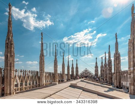 Milan Cathedral Roof On Sunny Day, Italy. Milan Cathedral Or Duomo Di Milano Is Top Tourist Attracti