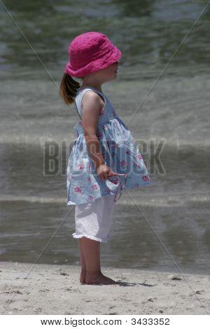 Child On Beach In Sundress