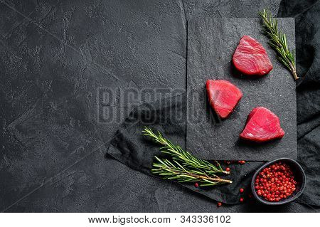 Raw Fillet Steak Tuna. Black Background. Top View. Space For Text
