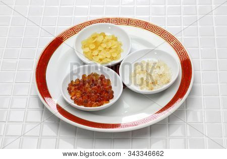 chinese dessert tong sui(Sweet Soup)ingredients ; peach gum, snow swallow and saponin rice poster
