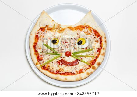 Children's Pizza In The Shape Of A Cat's Face On A White Plate
