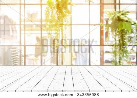 Perspective White Wooden Table On Top Over Blur Natural Background, Can Be Used Mock Up For Montage