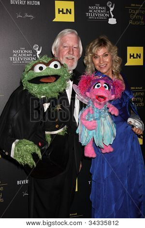 LOS ANGELES - JUN 23: Caroll Spinney, Leslie Carrara Rudolph with puppets Oscar the Grouch, left, Abby at the 2012 Daytime Emmy Awards at Beverly Hilton Hotel on June 23, 2012 in Beverly Hills, CA
