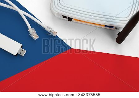 Czech Flag Depicted On Table With Internet Rj45 Cable, Wireless Usb Wifi Adapter And Router. Interne