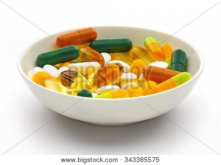 Plate with set of pills, tablets, vitamins, drugs, omega 3 fish oil, gel capsules, medicament and food supplement for health care. Pharmaceutical industry. Pharmacy.