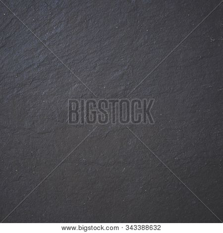 Black Stone Background Texture. Top View On A Solid Embossed Surface. Copy Space