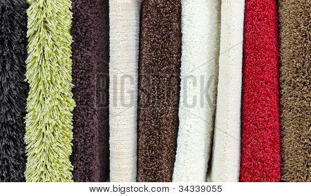 different colourful carpet samples a closeup shot poster
