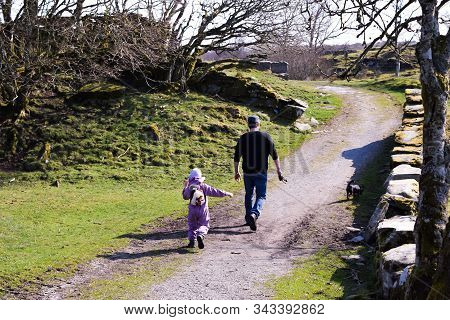 Father and child for a walk the spring season. Concept: walking with children, father and child, act