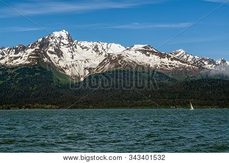 A Scenic View Of The Snow Capped Mountains Surrounding Resureection Bay In Kenai Fjords National Par