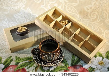 Chocolate Candy With Walnut Strong Pep Coffee Brown Cup Cardboard Box Background