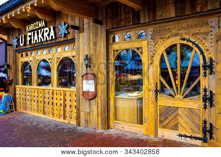 Zakopane, Poland - January 2, 2019: The Wooden Tavern At Krupowki Street In Zakopane Located In The