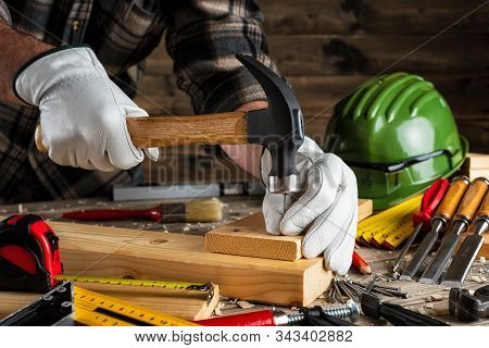 Carpenter At Work On Wooden Boards. Carpentry.
