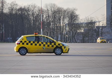 Krakow, Poland 20.12.2019: Two Yellow Toyota Yaris Airport Technical Service Cars Are Driving Along