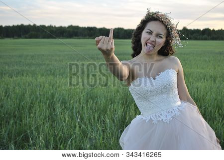 Bride At A Photo Shoot In A Wheat Field. The Bride Shows Her Ring Finger To The Camera. The Bride Ma