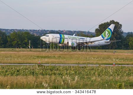 BUDAPEST, HUNGARY - CIRCA 2015: Airliner of Transavia landing at Budapest Liszt Ferenc Airport, Boeing 737-700 aircraft. Transavia is Dutch low-cost airline owned by KLM