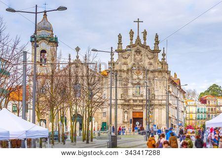 Porto, Portugal -april 1, 2018: Old Town Street View With Azulejo Tile Igreja Do Carmo Church, Peopl