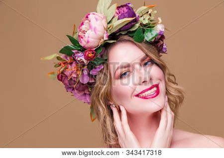 Happy Beautiful Young Woman Model With Bright Flowers On Her Head Smile On The Ocher Color Backgroun