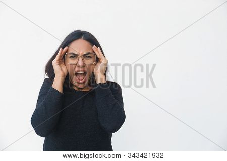 Surprised Exaggerated Woman Staring Away With Open Mouth. Beautiful Young Woman In Casual Sweater Po
