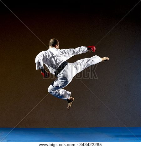 With A Black Belt, The Athlete Beats A Kick To The Side In A Jump