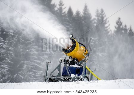 Snow Canon Machine On Slope In Ski Resort