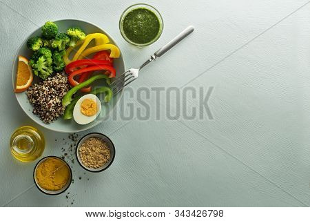 Healthy Meal Of Salad Bowl With Quinoa, Egg And Mixed Vegetables On Blue Background Top View. Food A