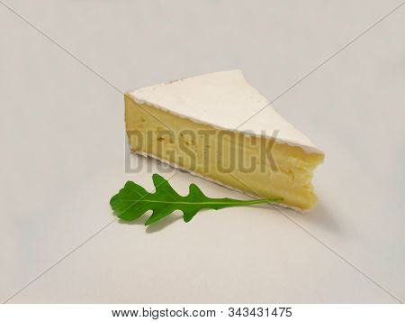 Brie Type Of Cheese. Fresh Brie Cheese And With Green Leavesrucola.