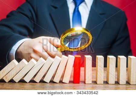 A Businessman Is Studying The Reason For Stopping The Fall Of Dominoes. Find The Stop Reason The Wor