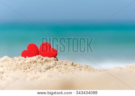 Valentine And Marry Concept.  Two Red Hearts Couple Lovers For Married Wedding In Summer Day On Sand