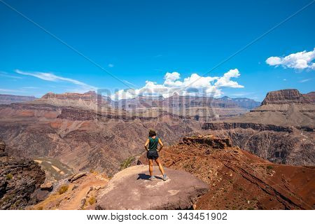 A Young Woman On A Viewpoint Of The South Kaibab Trailhead Trekking. Grand Canyon