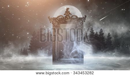 Dark Night Magic Scene. Magic Old Mirror In A Metal Frame On A Wooden Tabletop. Smoke, Magic, Magica