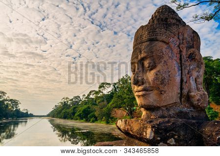 Details Of Stone Faces Sculpture And Rock Carvings At Gate Of Bayon Wat In Angkor Thom Temple, World