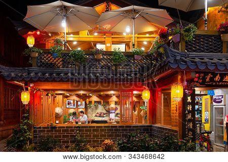 Lijiang, China - April 26, 2019: Traditional Naxi Restaurants In Lijiang Old Town At Night. Old Town