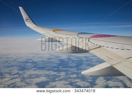 Lanzarote, Canary Islands - January 03, 2020: Wing Of A Condor Boeing 757 In The Blue Sky Flying Abo