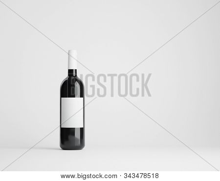 Single red wine bottle mockup over white. Label clipping path included. 3D render