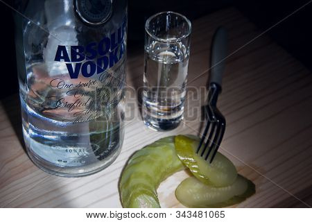 Izhevsk, Russia January 6, 2020: Bottle Of Absolut Vodka, A Glass And A Pickle Appetizer