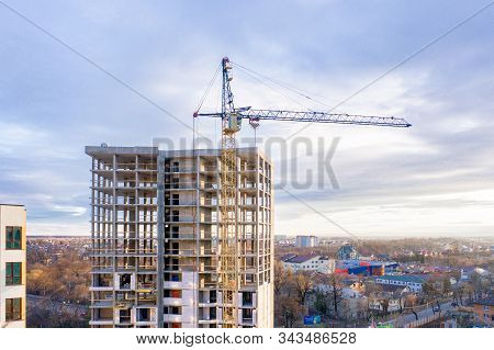 Photo Of A Multi-storey Building Under Construction. Construction Of A Residential Skyscraper. Backg