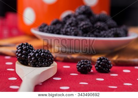 Wooden Tablespoon With Blackberries, Close-up. Plate With Berries Background, Cooking Or Eating Conc