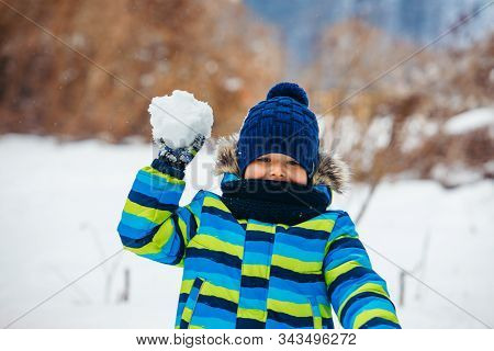 Little Boy Playing With Snow. Making Snowballs.
