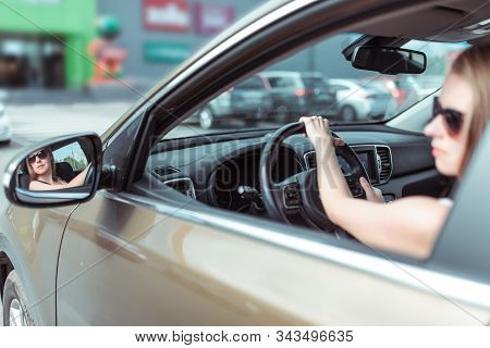 Woman Driving A Car, Looks At Side Rear-view Mirror, Reversing, Parking Shopping Center, Driving Car