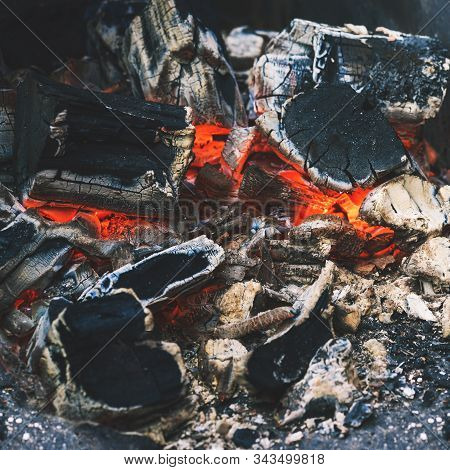 Smoldering Coal Close-up. Heat Source Remains Of A Bonfire. The Texture Of Ash And Coal