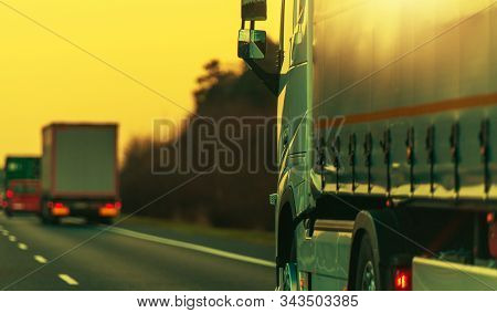 Heavy Transportation Semi Truck On A Highway Right After Sunset. Transport Industry.