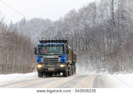 Asha, Russia - December 3, 2011: Blue Dump Truck Scania P380 At The Interurban Road Through The Snow