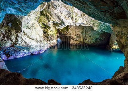 Grottoes Rosh - ha - Nikra - geological formation in northern Israel, on the border with Lebanon. Karst cave in the limestone mountain. The concept of active, environmental and photo tourism