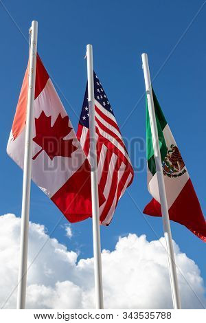 Flags Of United States, Mexico, Canada Flying Together, Concept Of New Nafta Agreement Now Known As