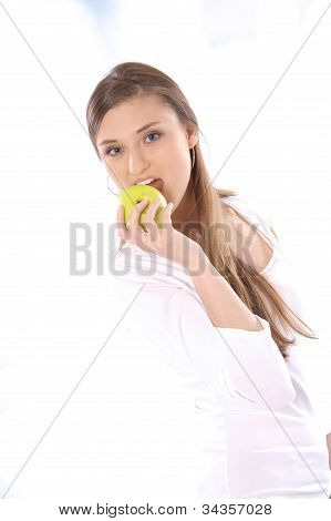 Portrait of happy beautiful young brunette woman with an apple